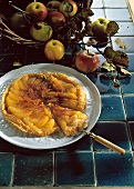 Apple tart with puff pastry, a piece cut