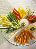 Fresh vegetables sticks with garlic, tomato & curry dips