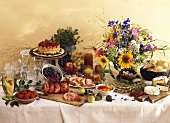 Country buffet with roast, fruit, cake, eggs, cheese etc