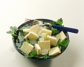 Butter Slices in Ice Water and Parsley
