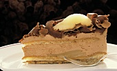 Chocolate cream gateau with pear and grated chocolate