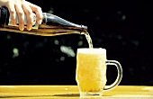 Pouring Beer from a Bottle to a Mug