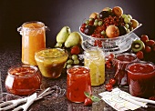 Several jams and preserves and fresh fruit on scales