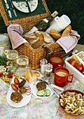 Picnic with a picnic basket, rissoles, pasta salad etc.