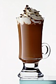 Hot chocolate with cream in tall glass