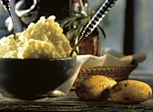 Mashed Potatoes in a Bowl; Fresh Whole Potatoes