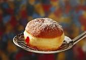 A fritter with jam on scoop
