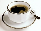 Single Cup of Coffee in a Silver-rimmed Cup