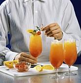 Preparing a Tequila Sunrise; Orange Slices and Cherries
