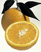 Half Orange and Whole Orange with Leaves