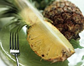 Pineapple Quarter on Plate with Fork