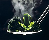 Steaming Broccoli on a Slotted Spoon