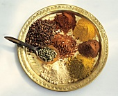 Assorted Exotic Spices on Brass Platter