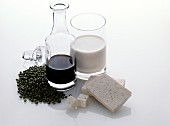 Still Life of Assorted Soy Products Soy Sauce Soy Beans Tofu and Soy Milk