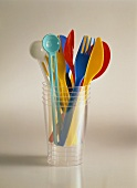 Colorful Plastic Utensils in a Plastic Cup