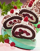 Chocolate sponge roulade filled with cream & raspberries