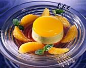 Pistachio-Orange Flan with Raspberry Sauce and Orange Slices