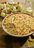 Rice bake with ham and courgette and salad bowl