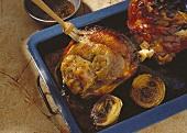 Pork knuckle with crackling is brushed with kümmel seasoning