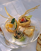 Stuffed fried linguine baskets and marinated sardines