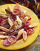 Beef and heart of palm salad with onion rings