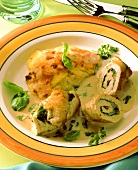 Turkey breast roulades with spinach stuffing & potato gratin