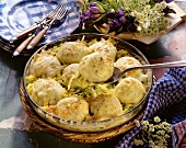 Old Bavarian dumpling casserole in round glass dish