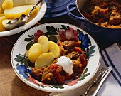Szeged goulash on plate with boiled potatoes