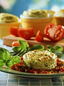 Herb potato souffle on tomato sauce