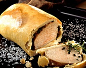 Smoked pork rib (Kassler) with herbs in bread dough