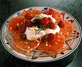 Grapefruit slices with yoghurt, raspberries & chopped nuts