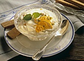 Orange yoghurt mousse in small bowl