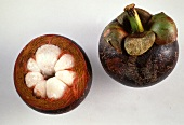 Whole and half mangosteen