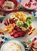 Fruit fondue: pieces of fresh fruit with sweet sauces & dips