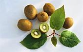 Five whole and one half kiwi fruit; leaves
