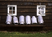 Milk cans in front of house (Zaanse Schans museum, Holland)