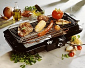 Assorted Meats and Vegetables on an Electric Grill