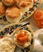 Scones spread with butter & preserved orange slices