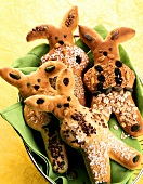 Bread Easter bunny decorated with grains, nuts, raisins etc