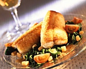 Eel fillet in potato crust on spinach & tomatoes