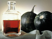 Pumpkin Oil in a Glass Bottle; Pumpkins
