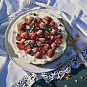 Strawberry and redcurrant gateau with cream