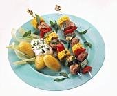 Meat & vegetable kebabs on plate with jacket potatoes & quark