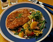Breaded escalope with almonds & potato & vegetable salad