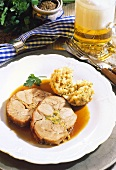 Roast pork roll with leek stuffing and bread dumpling