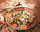 Mushroom salad with Camembert & chili herb dressing on plate