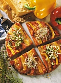 Pepper pizza with bean sprouts, cut into four