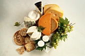 Still life with various types of cheese, bread & grapes