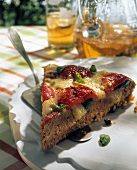 A piece of mince quiche with tomatoes & toasted cheese