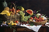 Fresh fruit in basket and bowl on old table